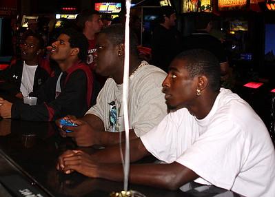 Jason Barnes, Melvin Ingram and Shaq Wilson play NCAA 09 on the big screen.