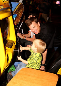 Coach Steve Spurrier Jr. And Son having a great time at Gameworks!