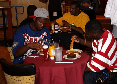 Freddie Brown and Kenny McKinley eating some Chicken strips