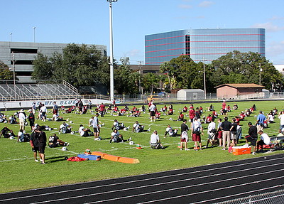 USC stretches before its first practice in Tampa.