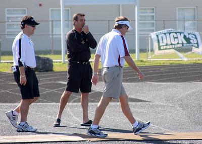 Spurrier walks off the practice field.
