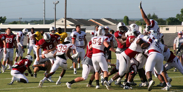Sanders with the hold, Wooten the kick