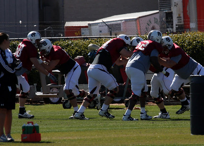O-Line going through blocking drills.