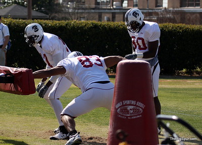 #83 Cliff Matthews does his  sled drill as Chaz Sutton #90 looks on