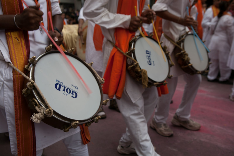 Playing the traditional beat instrument 'Tasha' Ganesh festival in Pune, India