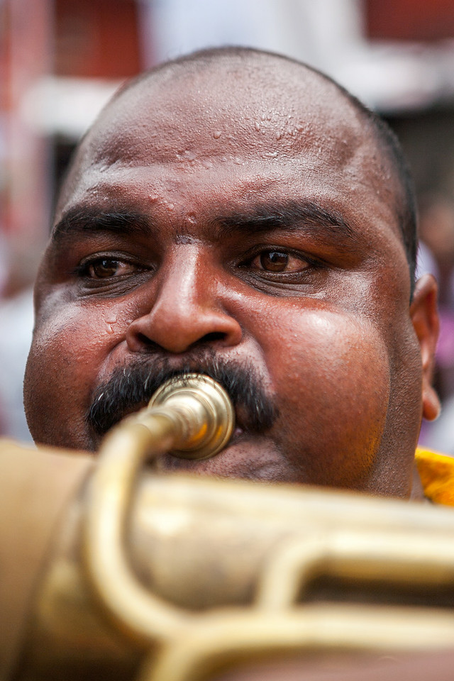 Musician playing the Tuba at Ganesh festival in Pune, India