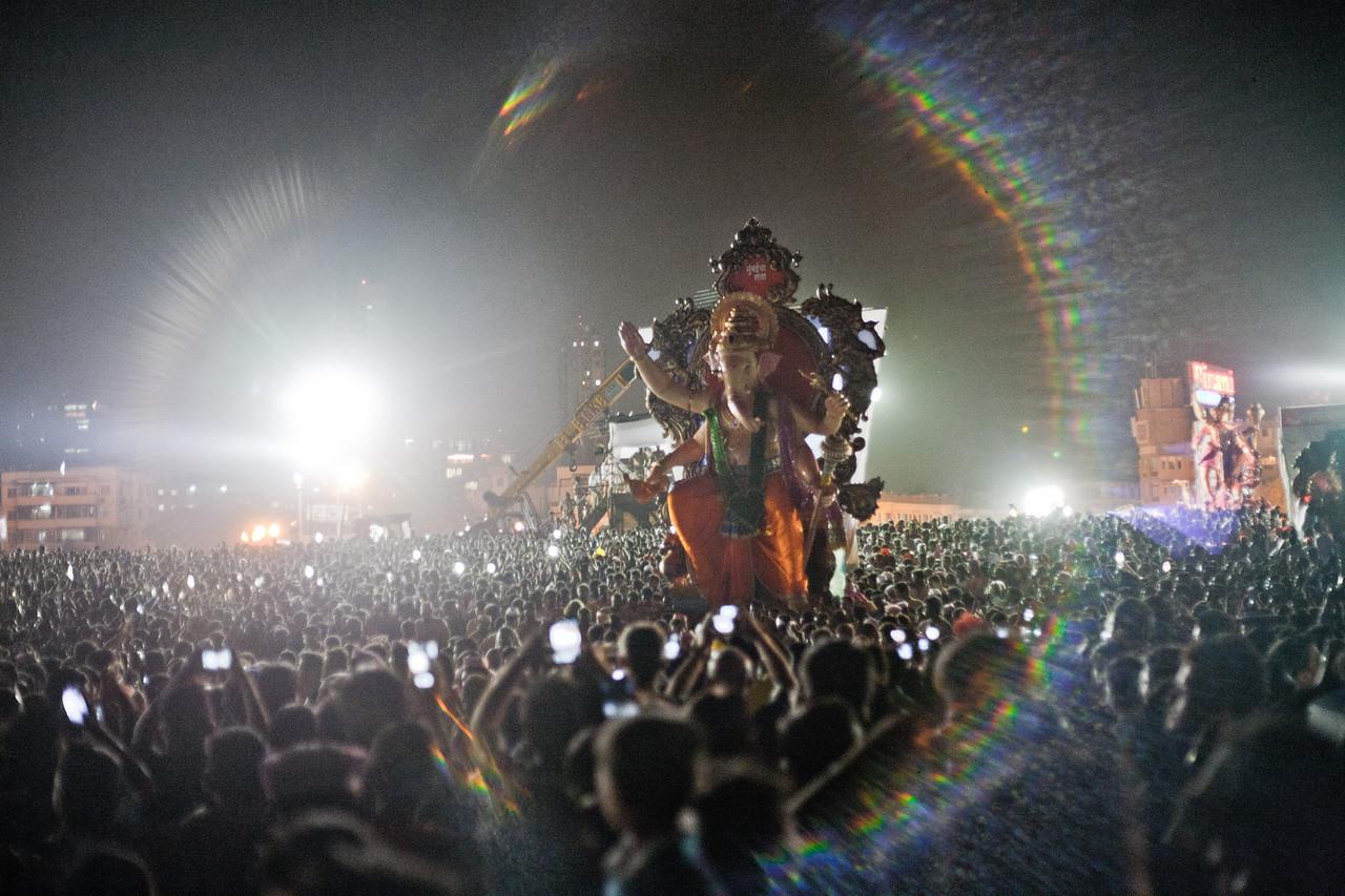 Lights, camera, action - Ganesh visarjan at Girgaum chowpatty in Mumbai, India