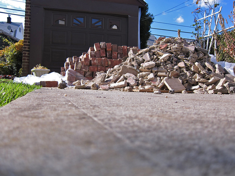 Rubble and brick in the driveway