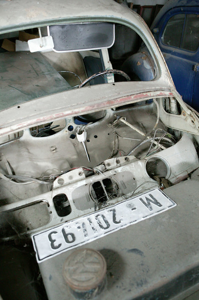 2-11<br /> This hulk of a VW Beetle carries the original plate, under the remains of the hood.