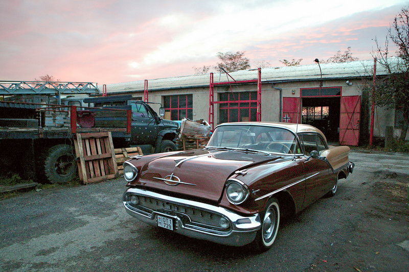 2-1<br /> Jankó István's garage near central Budapest is a collection of more than 170 cars that are housed in a complex of warehouses and lines of cars in the open that sprawls over several acres. The 1957 Oldsmobile Golden Rocket 88 is the owner's favorite.
