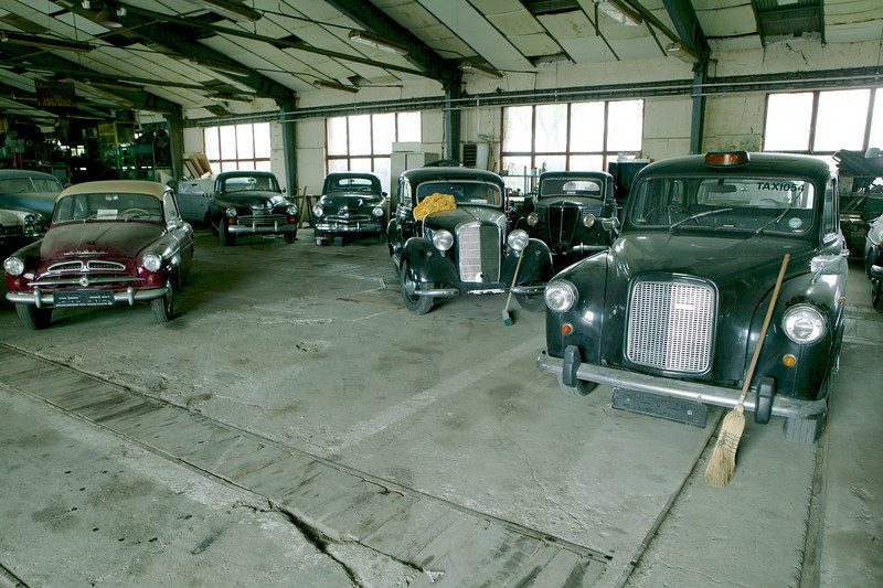 "2-6<br /> The collection ranges from early touring cars to 1990s machines, but a heavy focus is placed on cars from the 1950s. This room contains a 1978 Austin FX4 ""London Taxi,"" 1937 Renault Celtaquatre, 1952 Mercedes-Benz 170V, 1952 Pobeda M20, 1955 Skoda, and 1968 Cadillac De Ville convertible."