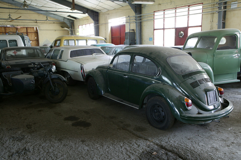 "2-20<br /> The Volkswagon Beetle emblazoned with ""Policia"" appeared in the movie, Munich. The motorcycle is a sidecar-equipped BMW R12 and Cadillac is a de Ville."