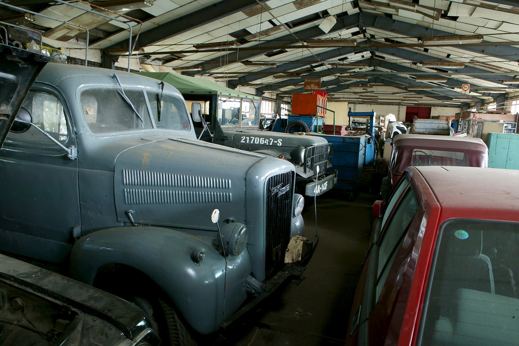 2-14<br /> A 1939 Opel Blitz and a 1941 Dodge Weapon carrier. The Blitz served the needs of the German military in World War II. Opel was owned by General Motors, and, in 1938, 29 percent of Opel's Blitz trucks were sold to the German military. The Dodge also served in World War II, although without the political controversy bore by the Blitz.