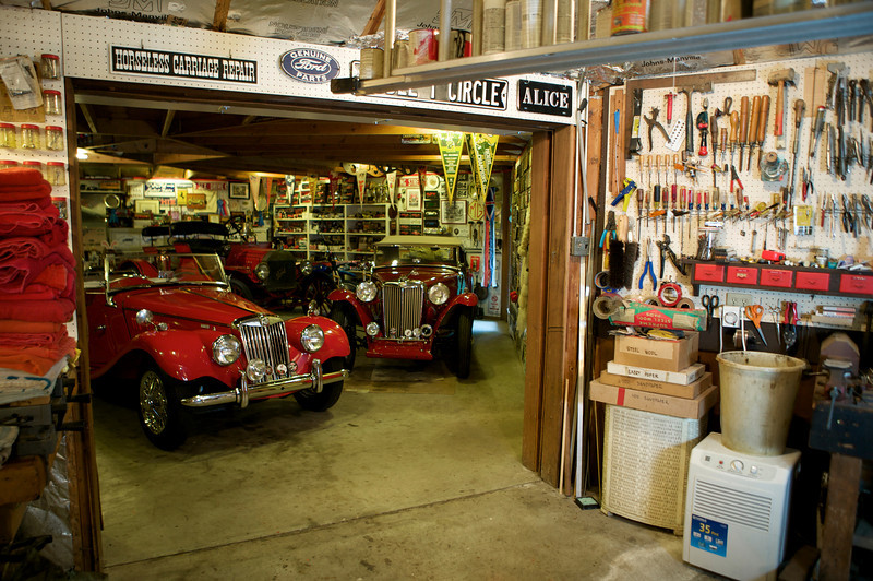 6-03<br /> Wirth's garage is a testament to 50 years of car collecting. An MG TF 1500 sits next to an [MG T?].  [Bob: What year and models are the MGs?]