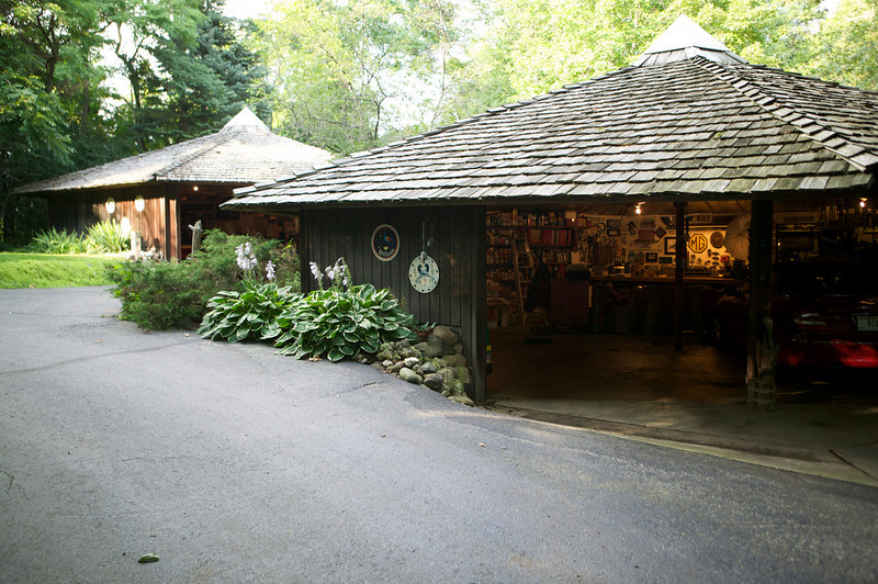 6-02<br /> Wirth's built three of these hexagon-shaped garages. The shape minimizes heat loss, and the redwood shingles give the place an organic look that blends nicely into the wooded lot.