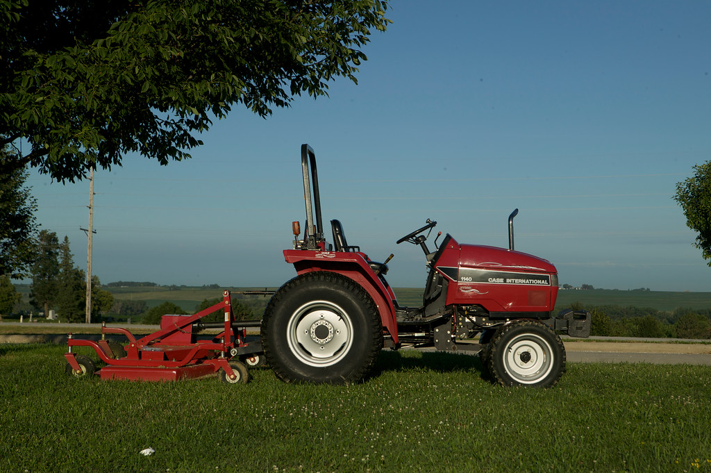 This Farmall 1140 owned by Jerry Mez handles the grass-cutting duites at Farmall-Land USA.