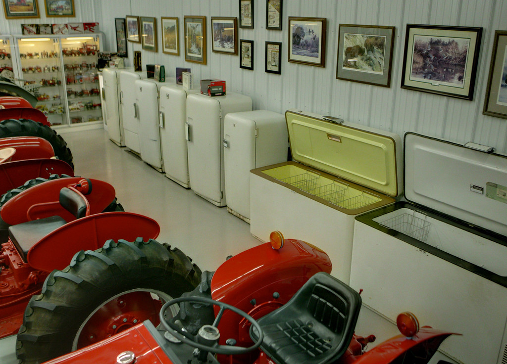 1-21<br /> The back room is also home for a few of the International Harvester line of freezers and refrigerators. A collection of tractor-related prints and paintings by Charles Freitag and others hang on the walls throughout the museum.