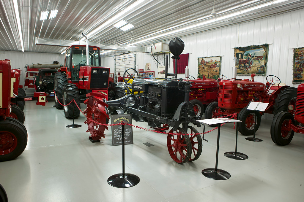 1-23<br /> Farmall-Land USA occasionally brings in tractors on loan to display. These two are the first 1924 Farmall Regular sold to the general public, serial number QC503, and the last International Harvester tractor produced, a model 5488 that was built by the Farmall plant in East Moline, Illinois on May 14, 1984.