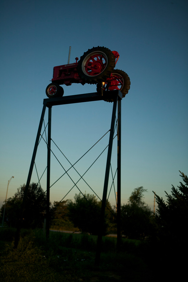 1-2<br /> This elevated tractor stands just outside the museum, and is visible from the road in front of the museum. Farmall-Land USA is located in far western Iowa, just a few hundred yards off of Interstate 80.