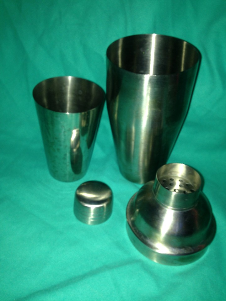 Stainless Steel 4 piece MARTINI SET with Bailey's written on it = $10/5,500-c
