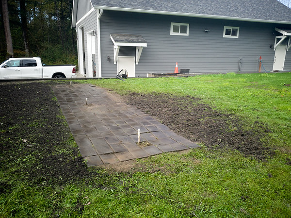 And its all gone. Look at how uneven my pavers ended up. That's what happens when you can't get a proper base layer in.