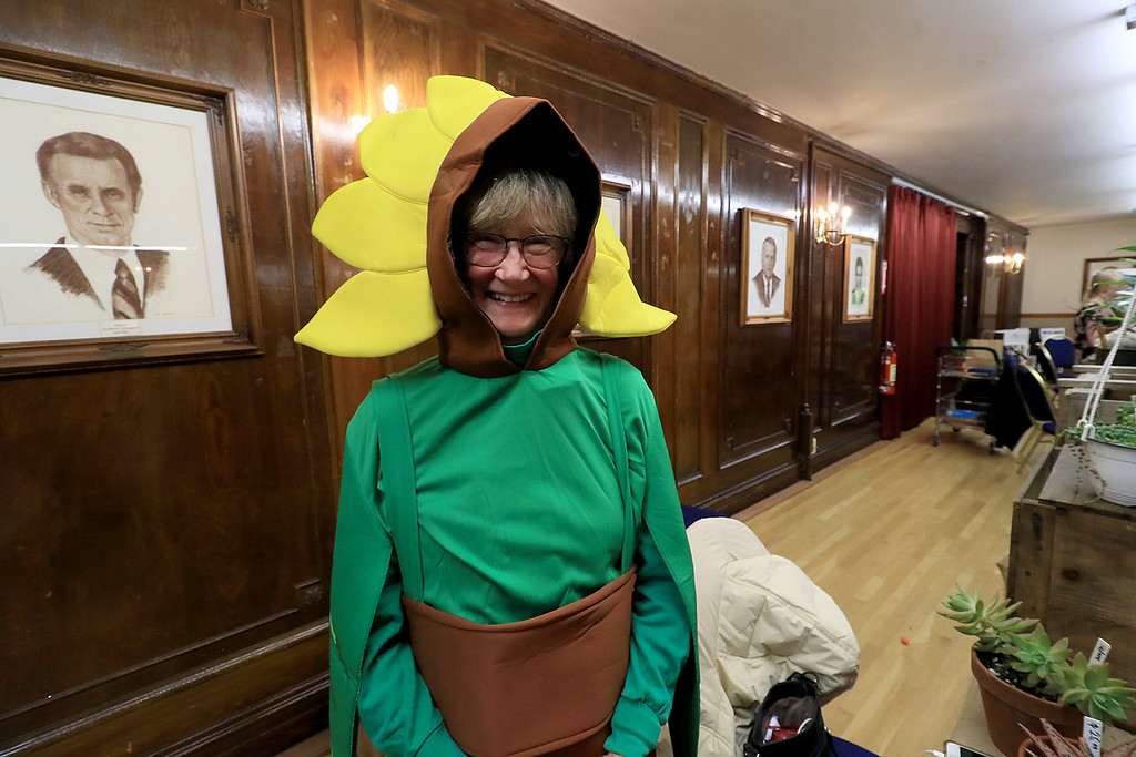 . Garden mania was held at the Leominster City Hall on Thursday night, January 31, 2019 the event was held so you could purchase items for your garden and to earn more about the resources available in the area. Kay Hillman with Buzz and Thrive of Leomisnter dressed up like a flower to man her table at the event. SENTINEL & ENTERPRISE/JOHN LOVE