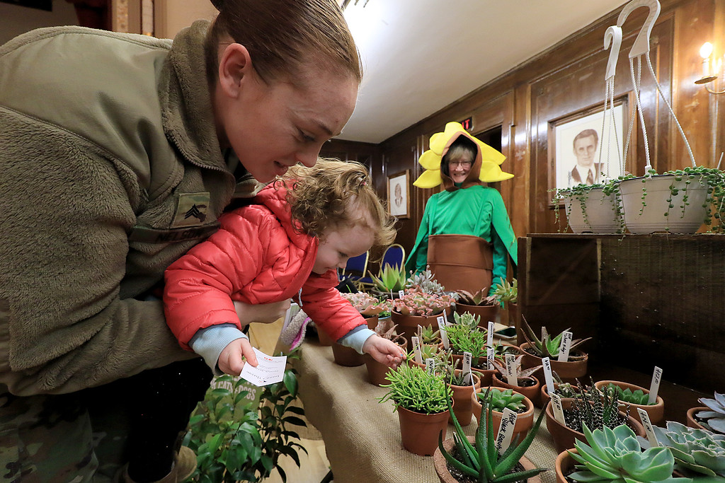 . Garden mania was held at the Leominster City Hall on Thursday night, January 31, 2019 the event was held so you could purchase items for your garden and to earn more about the resources available in the area. Army Sgt. Kelly Nelson and her daughter Emmeline Nelson, 2, of Leominster look over some of the plants at the Buzz and Thrive table during the event. SENTINEL & ENTERPRISE/JOHN LOVE