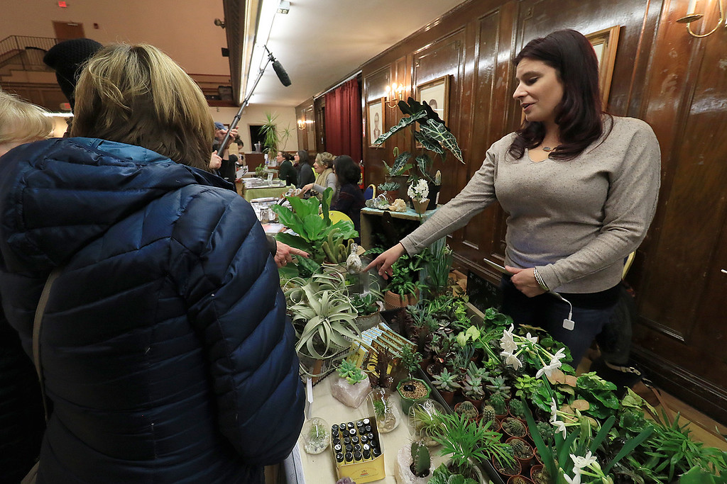 . Garden mania was held at the Leominster City Hall on Thursday night, January 31, 2019 the event was held so you could purchase items for your garden and to earn more about the resources available in the area. Kayla Nault owner of Sage Home Collections in Leominster chats with some of the people that came to garden mania about her plants she sells in her shop. SENTINEL & ENTERPRISE/JOHN LOVE
