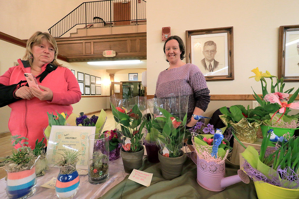 . Garden mania was held at the Leominster City Hall on Thursday night, January 31, 2019 the event was held so you could purchase items for your garden and to earn more about the resources available in the area. Nancy Kelly, on left, helped out Jessica Geddes owner of Dodo\'s Phlowers man her table during the event. SENTINEL & ENTERPRISE/JOHN LOVE