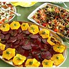 Buffet dish of beets and oranges