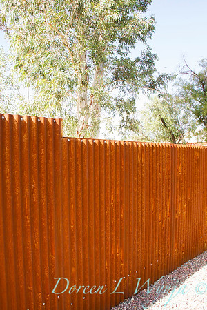 Corrugated rusty metal fencing_5773