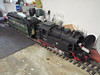 Battery powered loco charging on the bench.