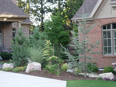 Good landscape design hides problems in your garden -- like air conditioners.
