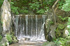 This waterfall and the rockery are built in sich a way that the sound of the water is amplified only to the front of it.