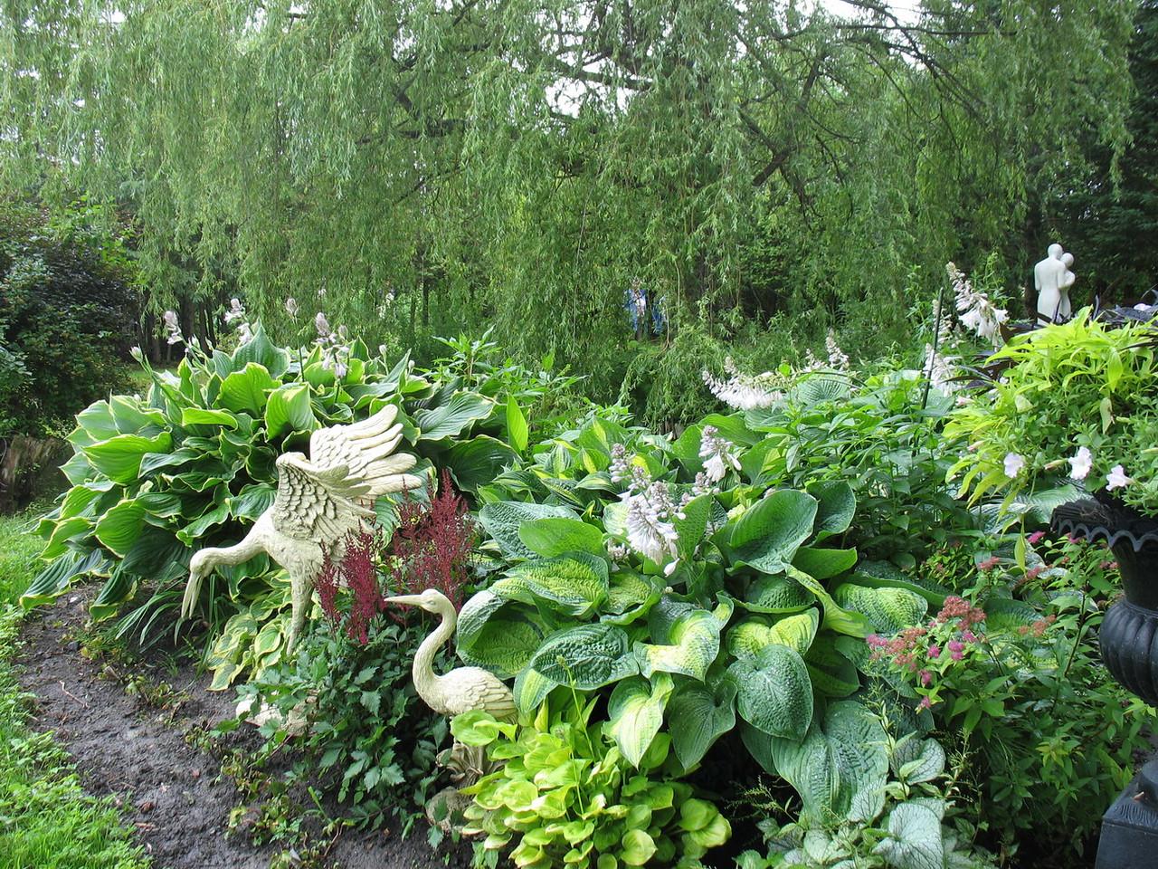 I enjoyed the large hostas and the garden art.