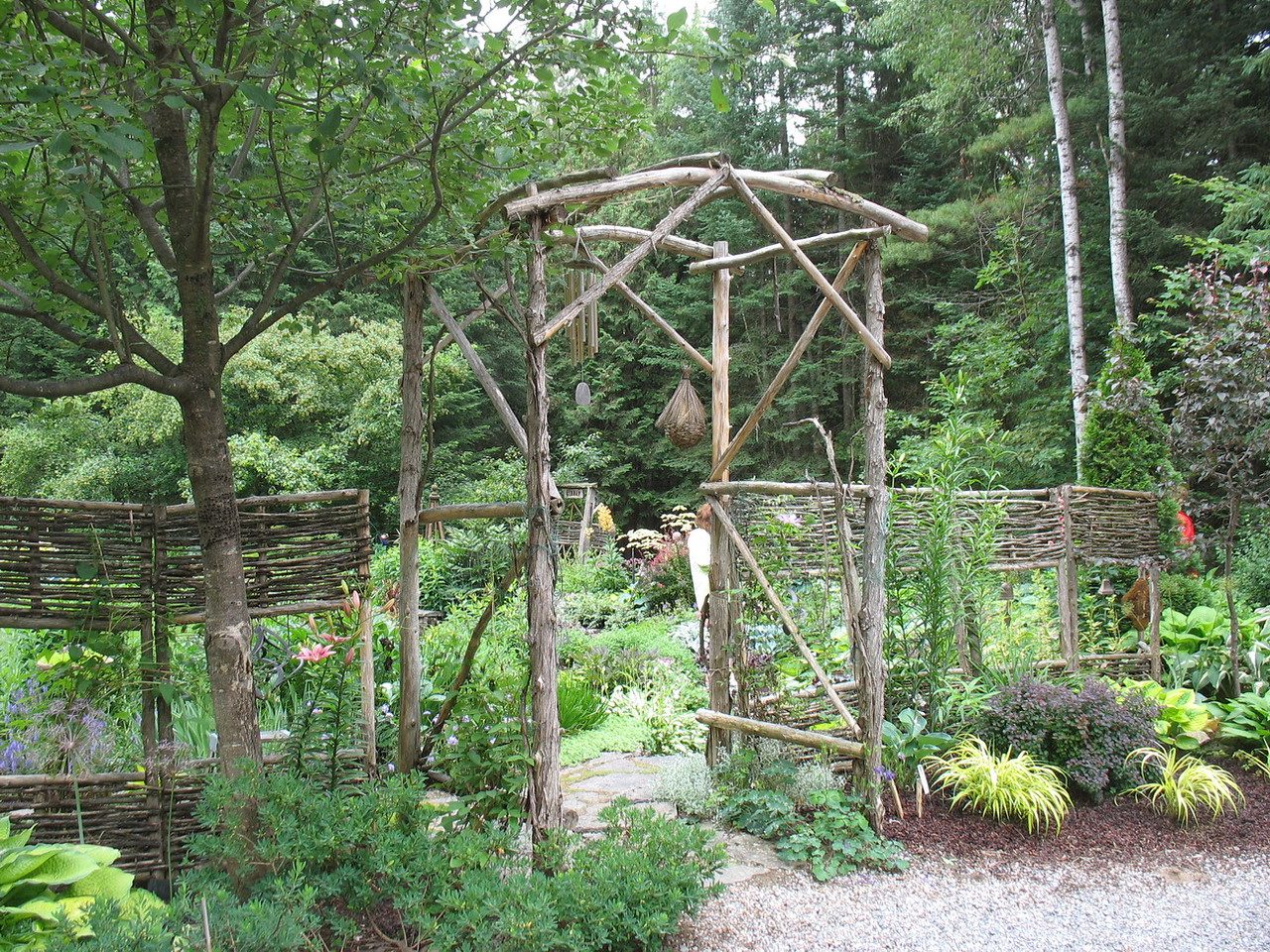 I love the bended twig fencing. I believe Sandy did this herself.