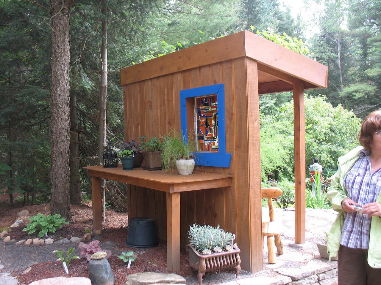 """The """"shack"""" facade hides a garden bench."""