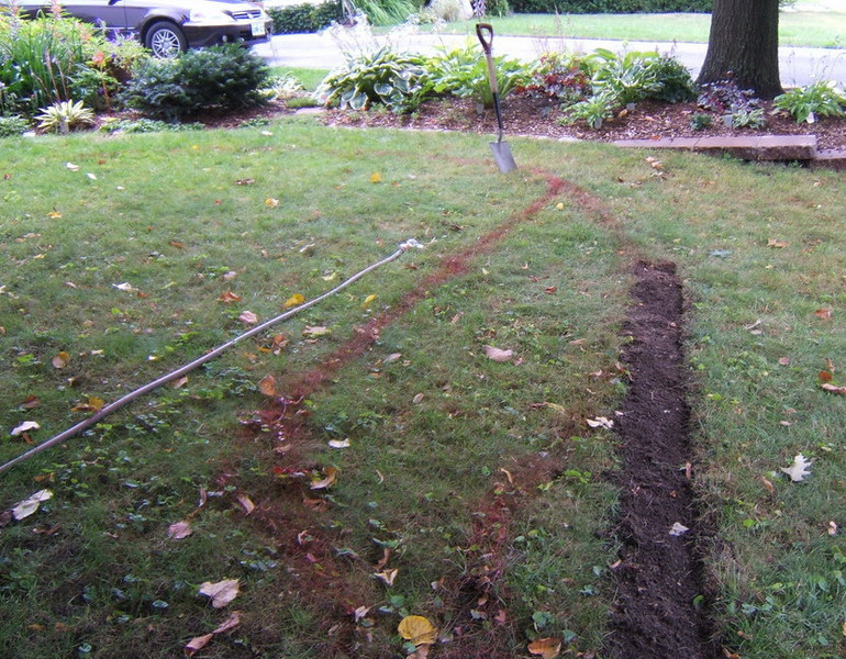 More done! The hose in this case was there to moisten the soil as it was dry under the trees and hard to work with.
