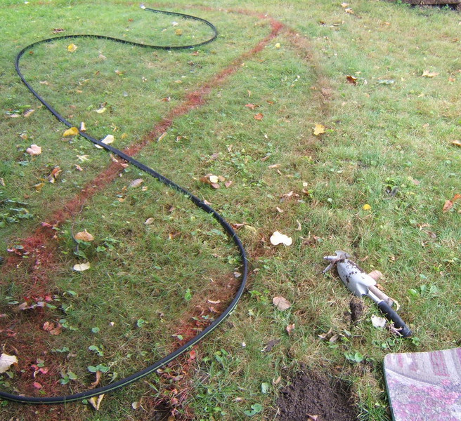 This took a few tries. (See the multiple strips of paint.) When I was happy, I began to lift a spade's width of sod around the edges of the garden.