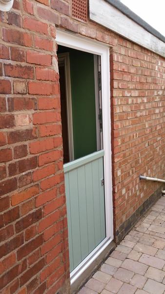 Back door top half open.