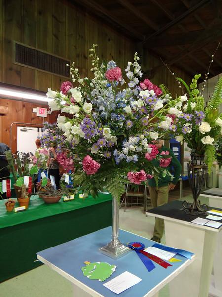 "European period floral design interpreting the class title ""A Wonderful Dream Come True"" won by Cindy Reiger"