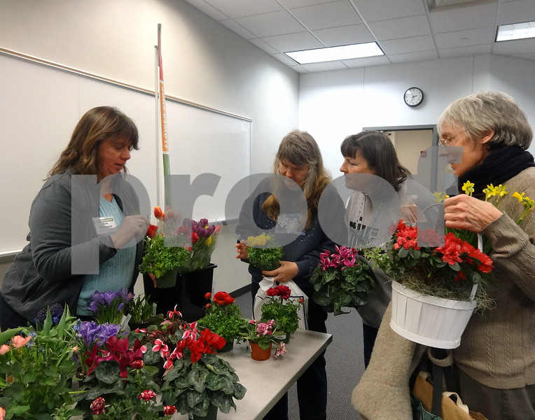 Attendees at the 2015 Gardener's Pathway symposium at the Kishwaukee College Conference Center were able to shop and discuss gardening with local vendors in the exhibit hall. The year's event will be held Feb. 25.