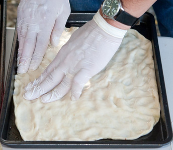 We're done spreading - the gloves make using the olive oil and spreading ingredients easier.