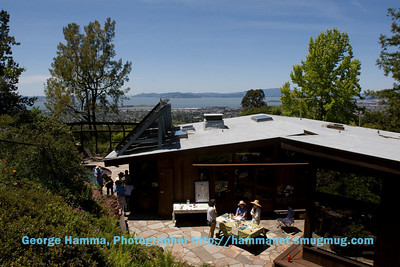 The house is well above the street, and the hill continues steeply above the house on the south side.  There are several deck areas, all with excellent views.  The information desk was very well sited.
