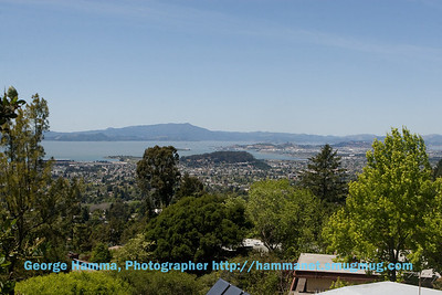 The view over the house from the top of the garden to the northwest and the north bay.