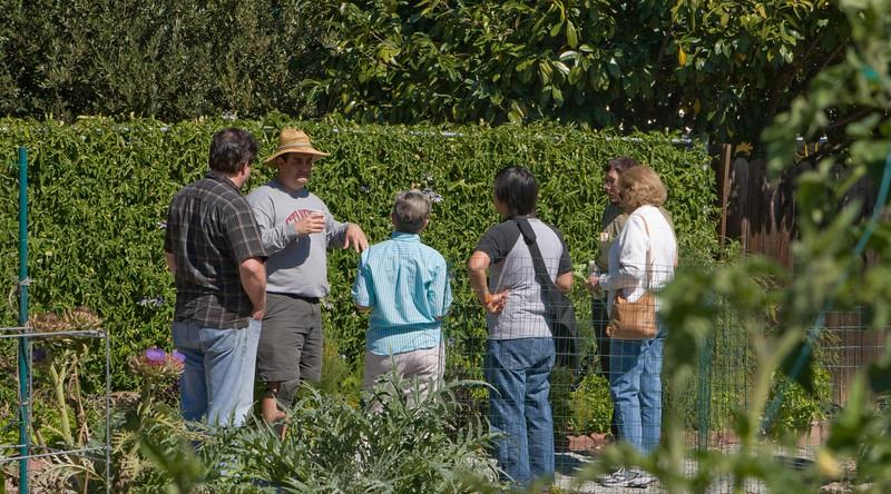 Showing visitors around the Garden.