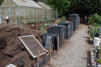 The compost bins, and finished compost pile for distribution to the garden plots