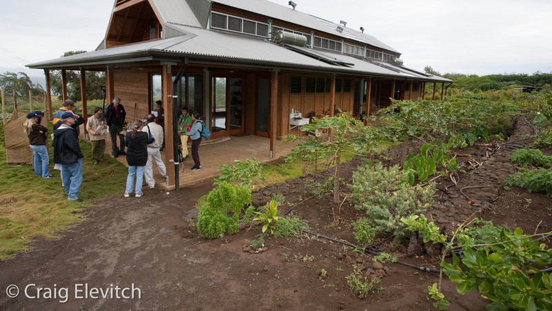 Tom Baldwin describes the edible landscaping around his recently constructed solar-powered home.