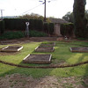 12.6.2008 The Plan Evolving - Stretched a piece of twine from the center of the middle bed and used an aerosol paint can to outline a 25' circle, then proceeded to dig out the lawn.