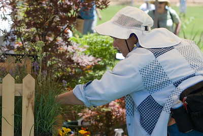 Master Gardeners can't resist shopping among the plant offerings.